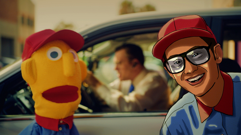 The puppet and the cartoon MC from the 'All new Yaris vs Gadget Guy' ad