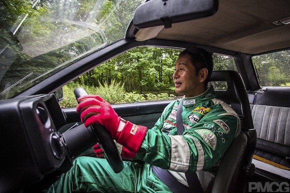 Keiichi Tsuchiya driving Toyota Corolla AE86