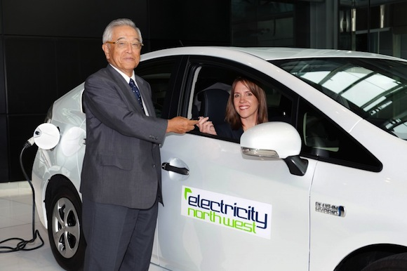 Dr Shoichiro Toyoda hands over the first Prius Plug-in hybrid
