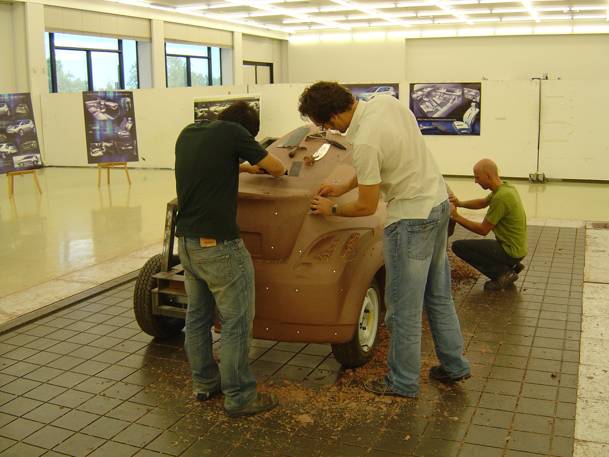 Car designers sculpting clay at ED2