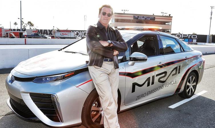 Arnold Schwarzenegger drives Toyota Mirai ahead of NASCAR