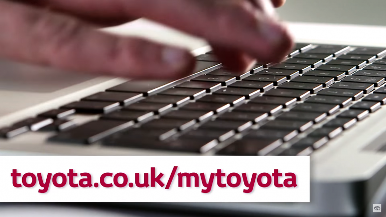 Man types on keyboard accessing MyToyota