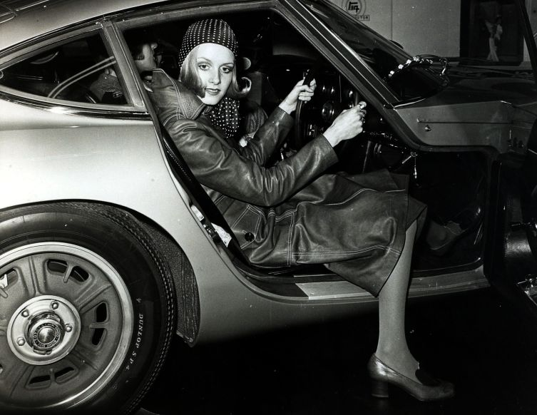 Personalities, Modelling, pic: 8th February 1968, London, British model Twiggy wearing 1930's style maxi coat and spotted headscarf takes delivery of her new Toyota 2000 GT sports car (Photo by Bentley Archive/Popperfoto/Getty Images)