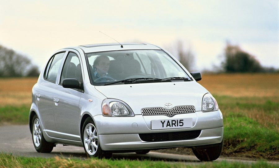 First-generation Toyota Yaris driving around corner