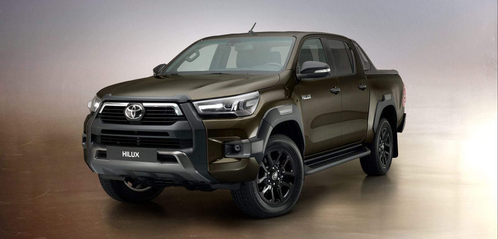 2021 Toyota Hilux in Titan Bronze - front-three-quarter
