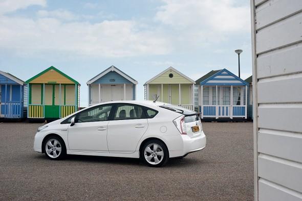 White Prius rear plate change beach hut