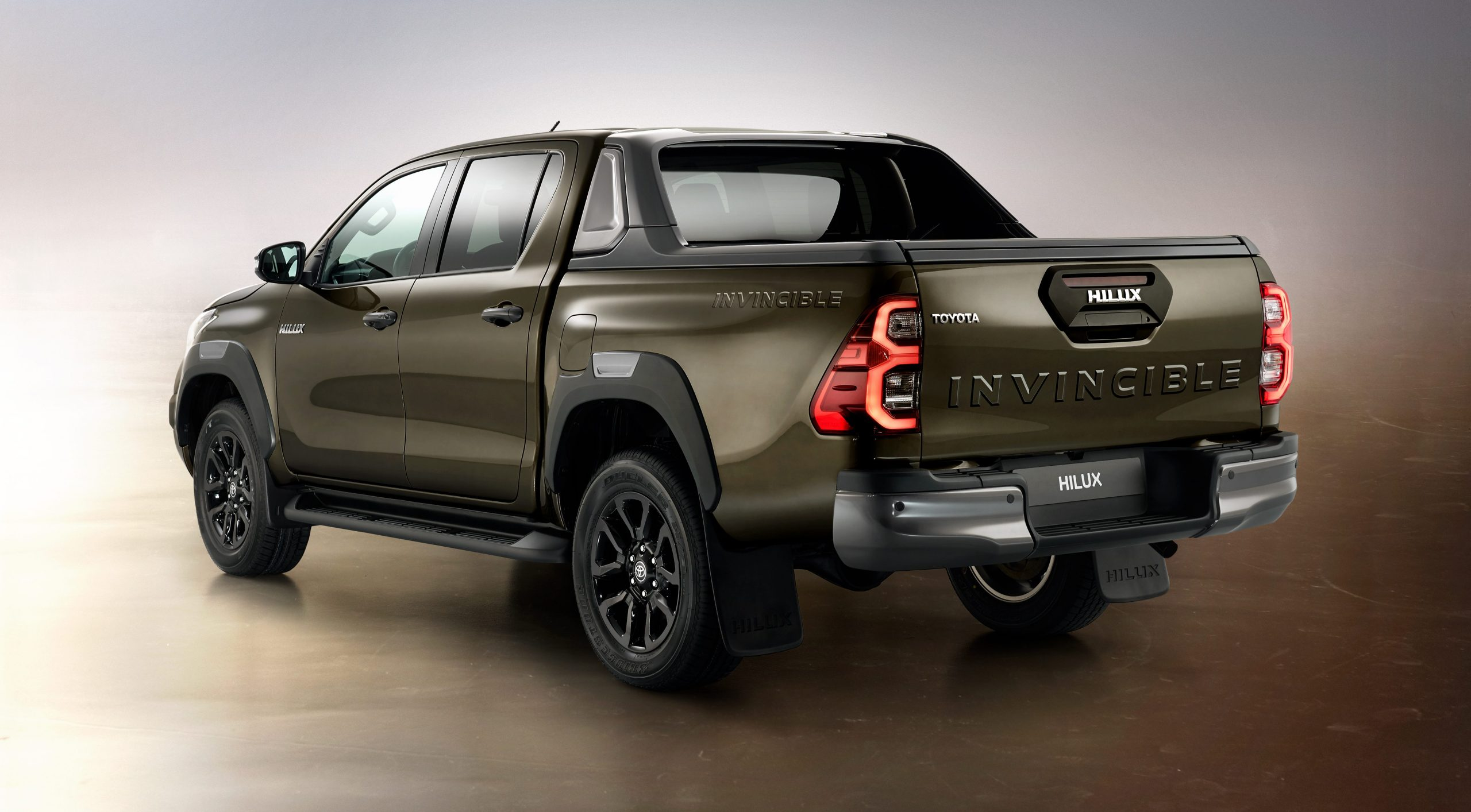 2021 Toyota Hilux Invincible in Titan Bronze - rear three-quarter