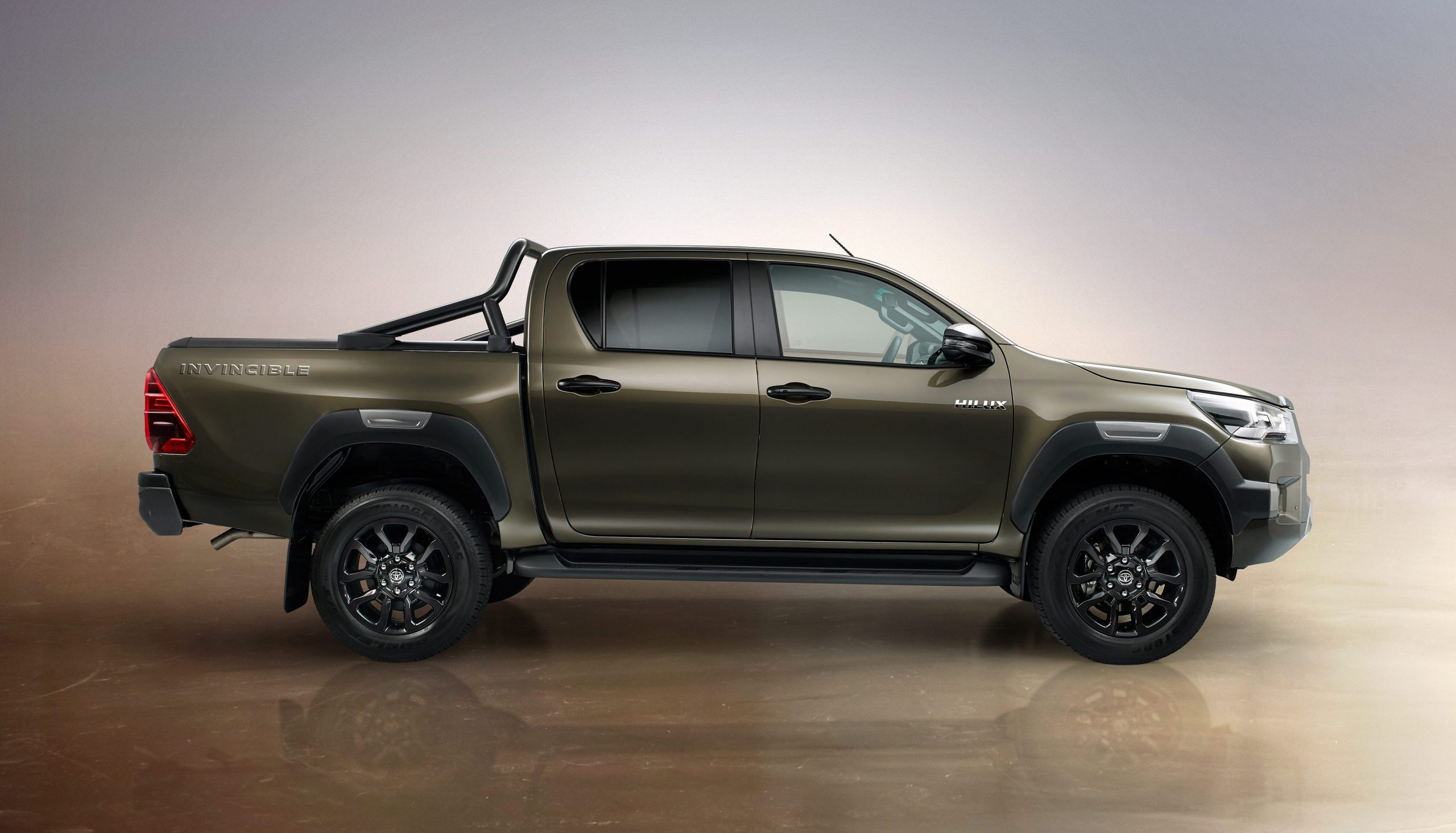 2021 Toyota Hilux Invincible in Titan Bronze - side profile view