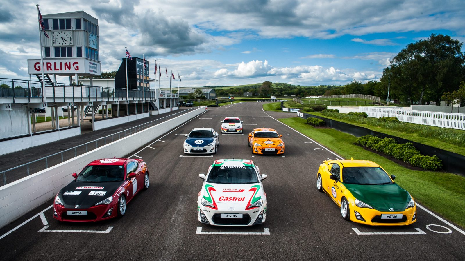 Six Toyota GT86s with retro liveries line up on the grid at Goodwood