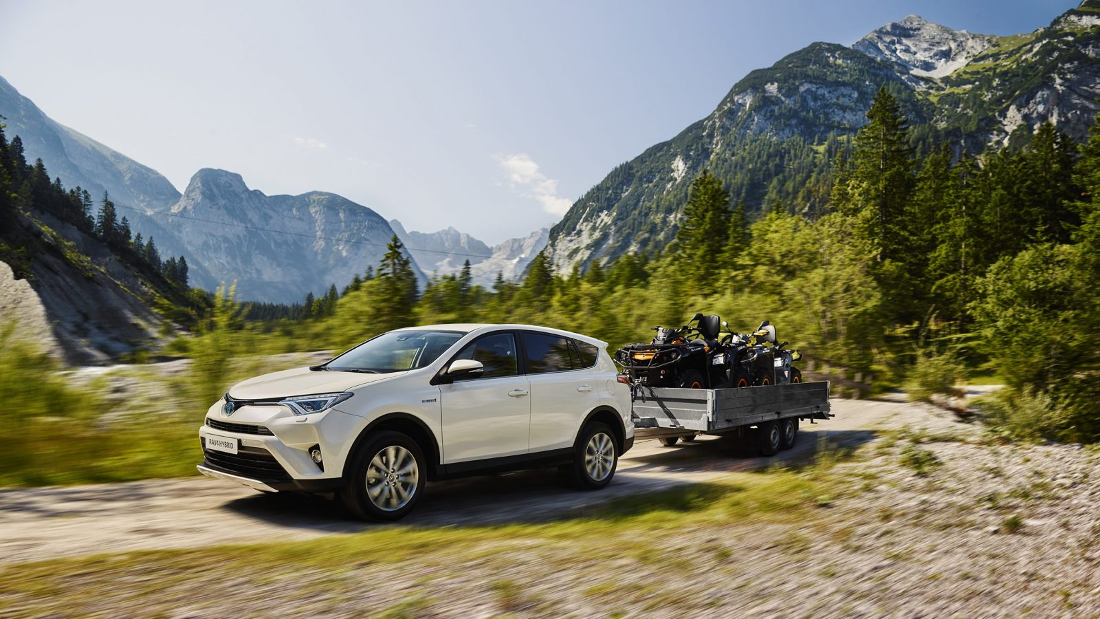 Toyota RAV4 Hybrid tows a trailer off-road