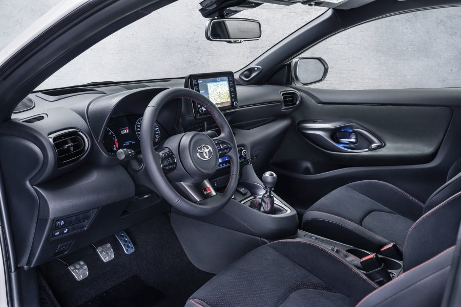 Interior view of Toyota GR Yaris - dashboard, steering wheel and centre console