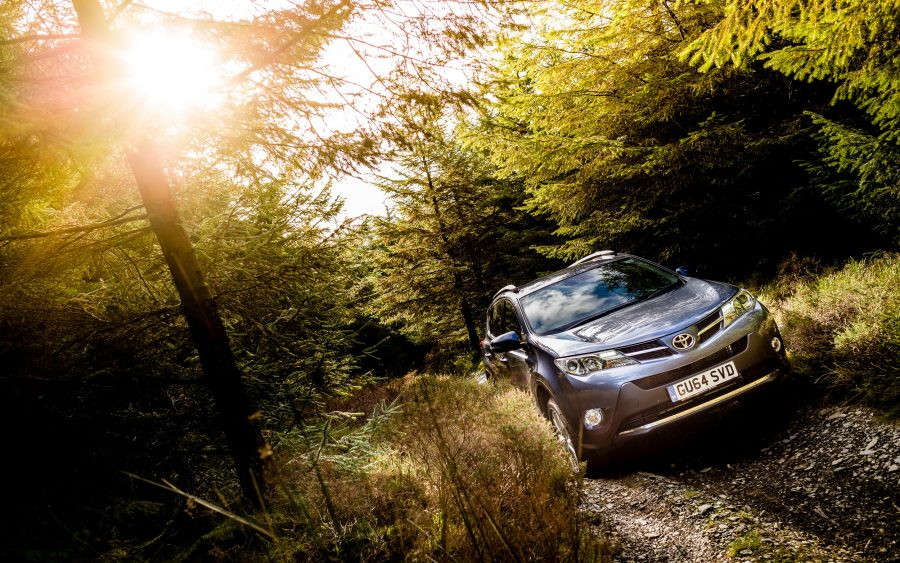 Toyota RAV4 Hybrid drives along gravel lane