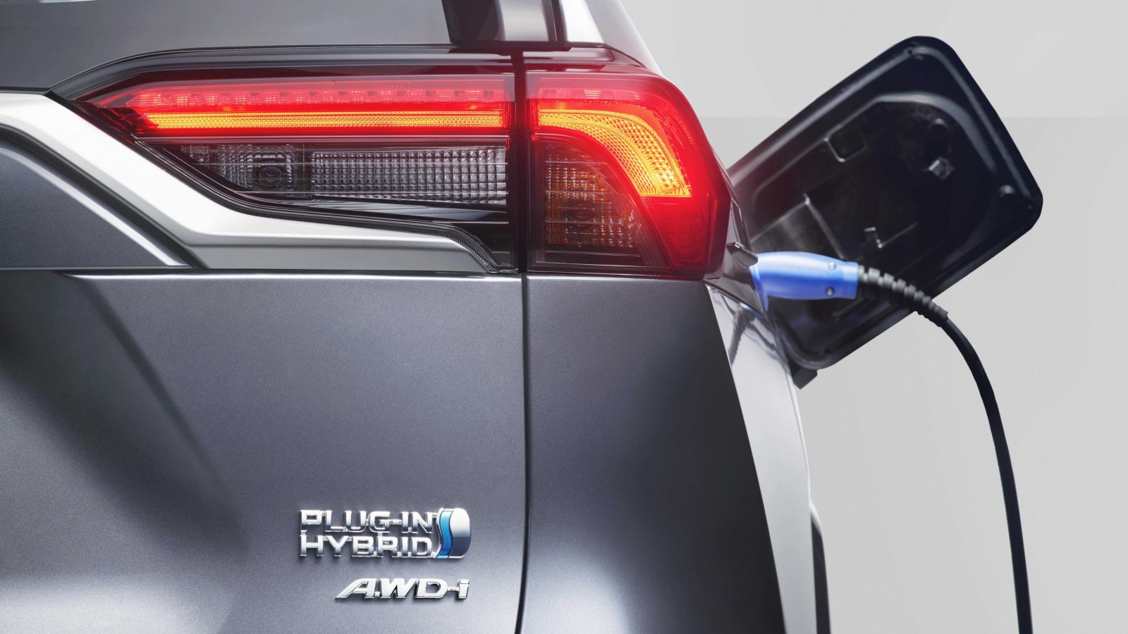 Toyota RAV4 Plug-in Hybrid - detail of charging point and rear badge