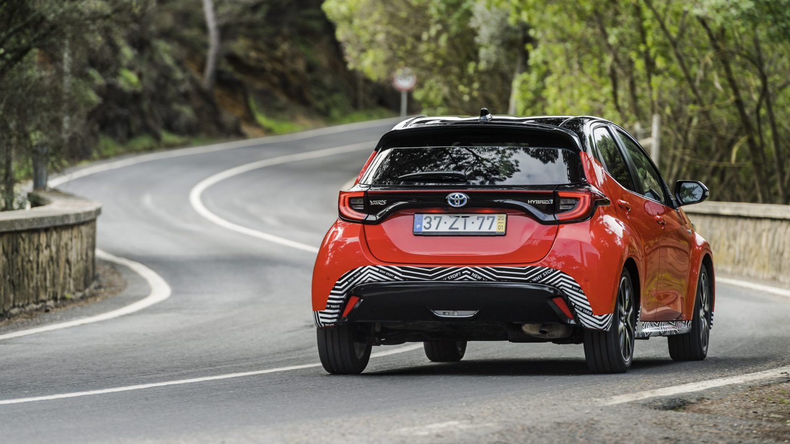 Rear view of prototype Toyota Yaris driving through twisting corners
